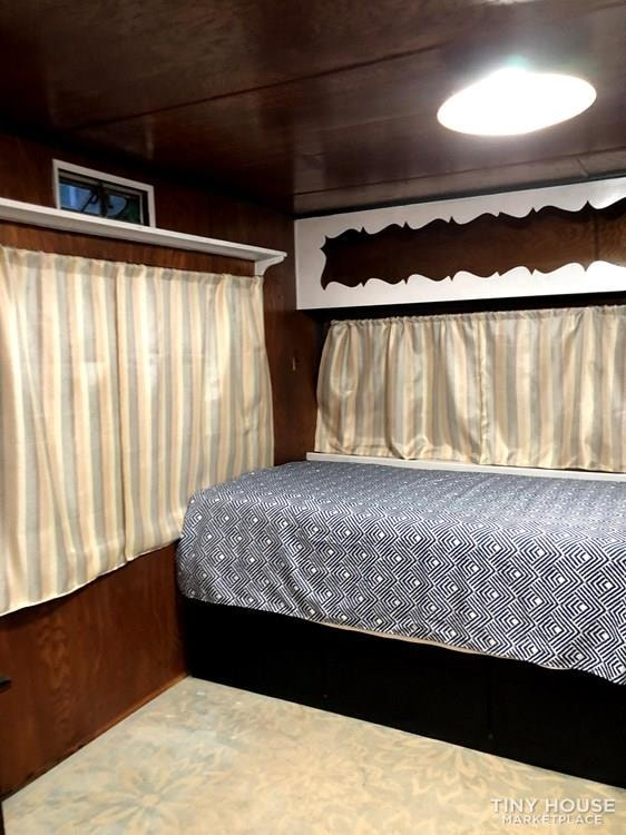 10' x 38' 1957 Mayflower one bedroom travel trailer with beautiful wood interior - Slide 7