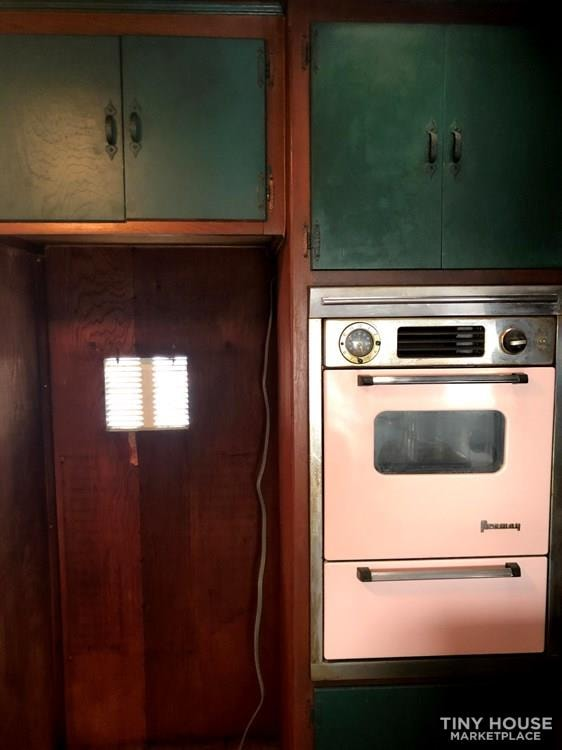 10' x 38' 1957 Mayflower one bedroom travel trailer with beautiful wood interior - Slide 11