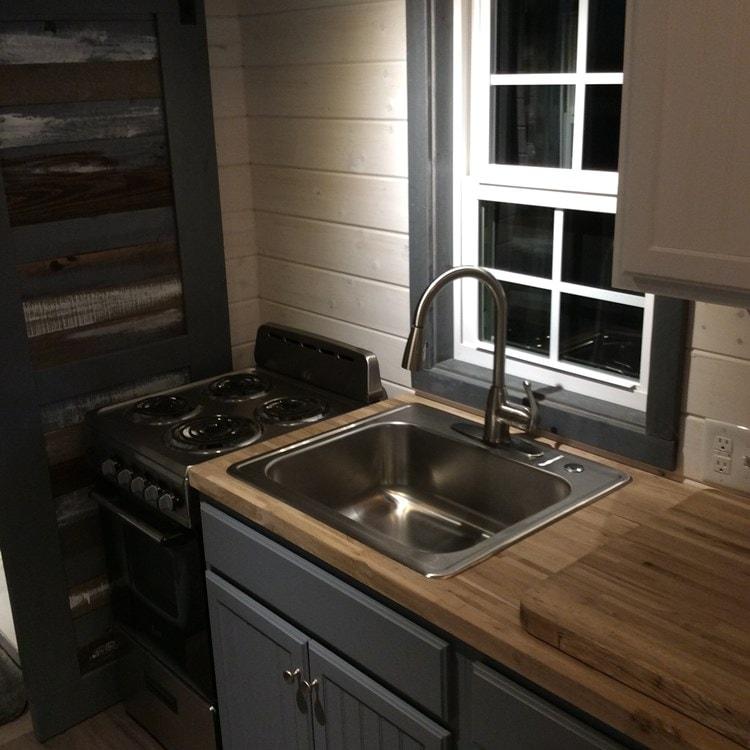 MODEL HOME REDUCED to make room for production  - Slide 11