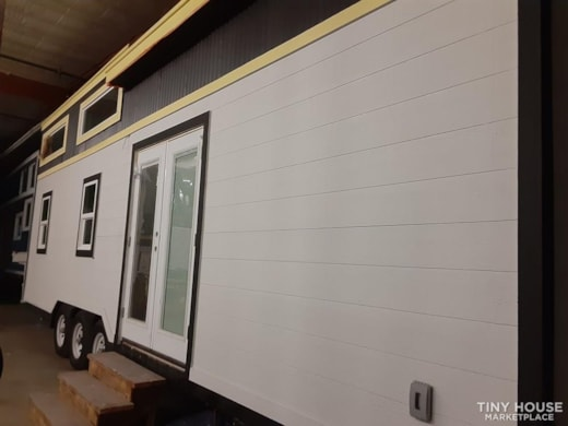 30' Tiny House with two Queen Lofts, large living or third bedroom.