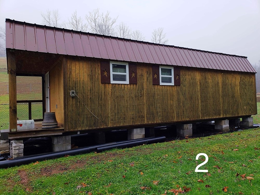 Cabin Style Tiny House with Covered Porch - Slide 2