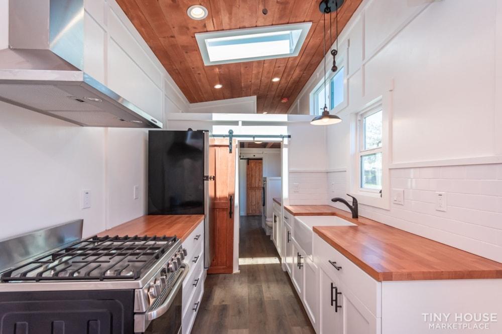 Custom 3 Bedroom 8.5' x 32' Tiny Home On Wheels - Slide 1