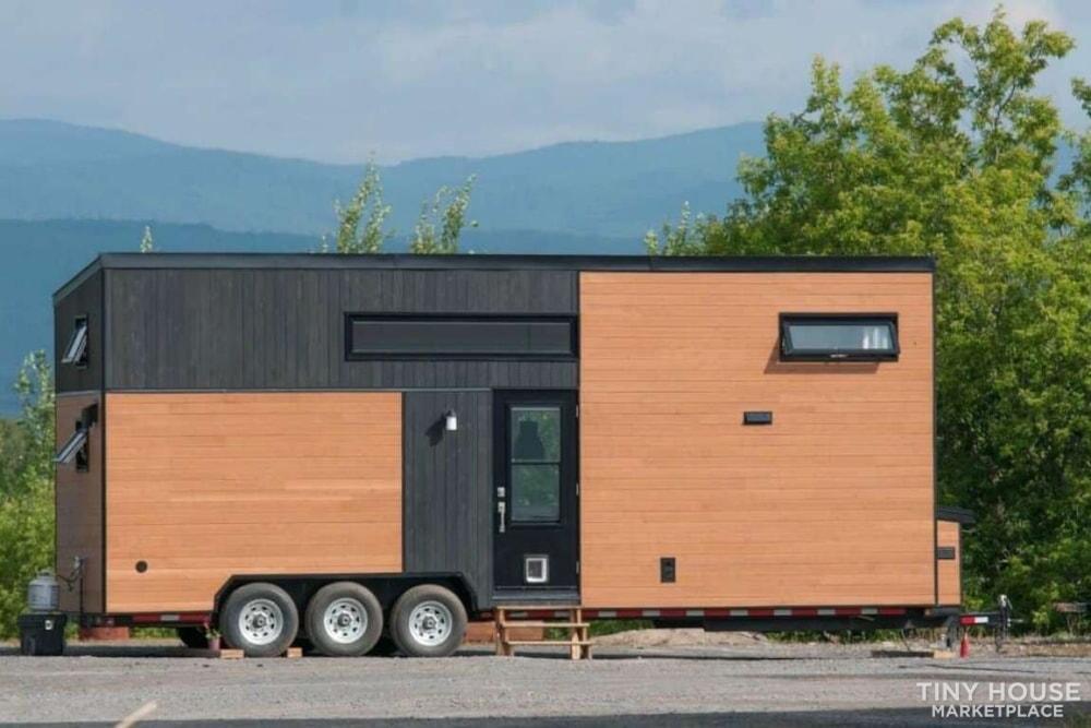 Custom-Built Luxury Modern Off-Grid Tiny Home by Minimaliste - Slide 1