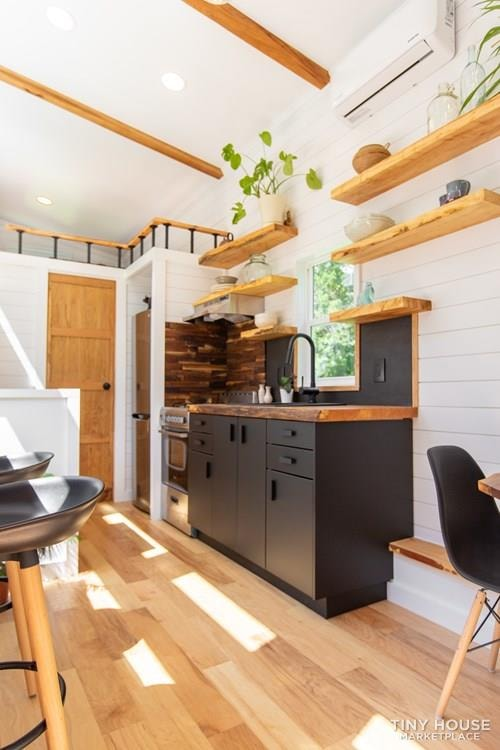 Natural Modern Luxury 26ft Tiny House on Trailer by Made Relative - Slide 11
