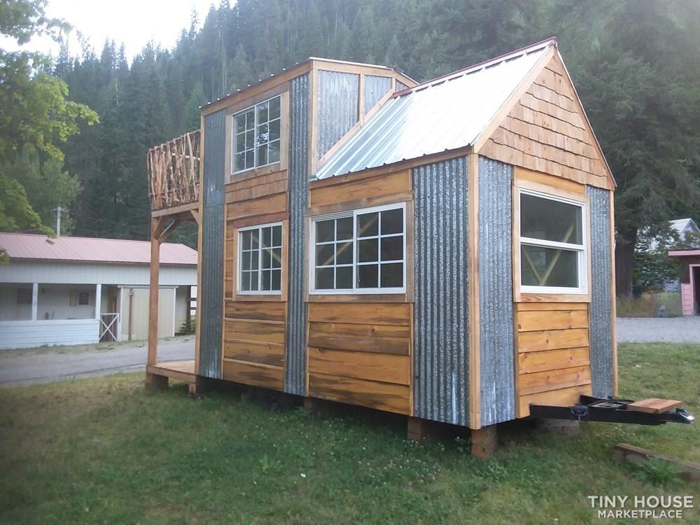 Single loft rocky mountain tiny house on wheels  - Slide 1