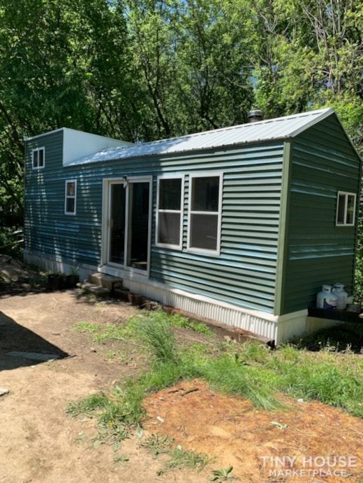 Three bedroom tiny house on trailer.